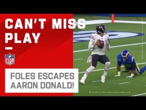 aaron-donald-nearly-gets-nick-foles-as-he-completes-a-pass-to-cole-kmet.jpg
